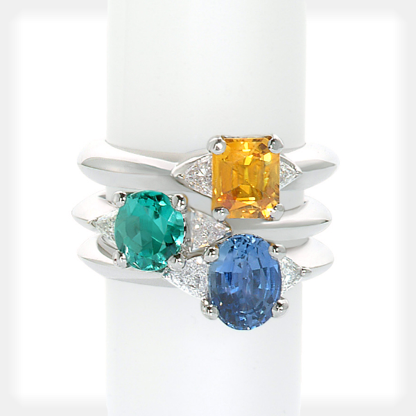 Women's Assorted Gemstone Rings with Pear Sidestones by Philip Zahm
